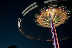 picture of carnival ride  - Lights moving in circle on carnival - JPG