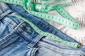 Jeans And A Measuring Tape.concept Of Loosing Weight.fruits For Weight Loss poster