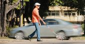 Blind Man Crossing The Road With Cars And Traffic poster