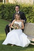 foto of wedding couple  - a marriage pair is happy in a green park - JPG