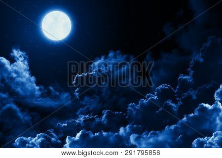 poster of Mystical Bright Full Moon In The Midnight Sky With Stars Surrounded By Dramatic Clouds. Dark Natural