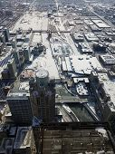 Aerial Elevated View Up Above Chicago And Looking Down At The Chicago River Covered In Ice During Th poster