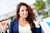 picture of payment methods  - Shopping woman holding a credit or debit card - JPG