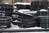 Plastic Pipes In The Finished Goods Warehouse Are Stacked In Packs In The Snow poster