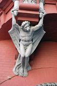Architecture demon with wings on wall of house in Kiev, Ukraine