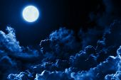 Mystical Bright Full Moon In The Midnight Sky With Stars Surrounded By Dramatic Clouds. Dark Natural poster