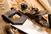 stock photo of joinery  - set of carpenters tool on the wood and shavings - JPG