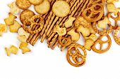 Many Salty Crackers, Sticks, Pretzels, And Gold Fishes, Shot From The Top On A White Background With poster