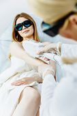 A Beautiful Girl Lies In The Office Of A Beautician In Red Goggles From Laser Irradiation, The Hands poster