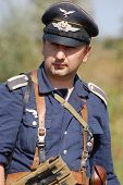 KIEV, UKRAINE -SEPT 18 :  Unidentified member of Red Star history club wears historical German Luftwaffe  uniform during historical reenactment of WWII, September 18, 2011 in Kiev, Ukraine