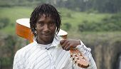African Busker With Guitar On Shoulder And Ten Rand Note