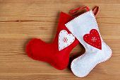 Handmade Christmas stockings on a wooden background with copy space.