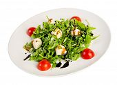 Salad from eruca and cheese on a white background