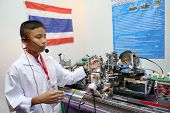 SUBANG JAYA - NOVEMBER 10: An unidentified student from Thailand explains his project at the World R