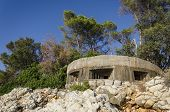 stock photo of former yugoslavia  - Machine gun nest on island of Grgur in Croatia is remain of guard watch that was preventing escape of female political prisioners of former Yugoslavia - JPG