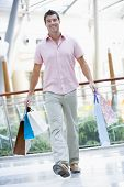 Man In Shopping Mall With Bags