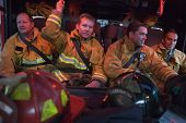 Firefighters In Engine Taking Off Uniform