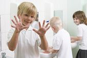 Children Washing Hands In Classroom Sinks