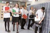 Teens In School Corridor On Way To Class