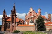 St. Anne's Church and Saints Francis and Bernardine Church and Adam Mitskevich statue in Vilnius,  Lithuania.