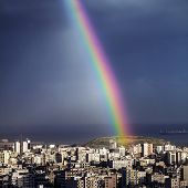 foto of natural phenomena  - Photo of bright colorful rainbow over city - JPG