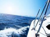 Photo of a 43 foot sailboat in action, speeding at open blue sea, parts of a luxury yacht boat, extr