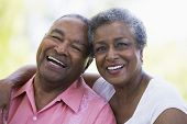 stock photo of 70-year-old  - Senior couple sitting outdoors - JPG