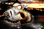 stock photo of drama  - Venetian Mask by the River Bridge with Sunset - JPG
