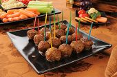 image of meatballs  - Swedish meatballs and a vegetable platter on a buffet table