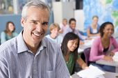 stock photo of student teacher  - Students studying in geography class with teacher - JPG