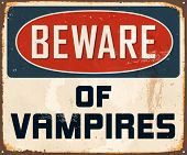Vintage Metal Sign - Beware of Vampires - Vector EPS10. Grunge effects can be easily removed for a brand new, clean design.