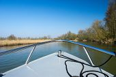 Little motorboat in Dutch Biesbosch nature