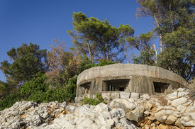 image of former yugoslavia  - Machine gun nest on island of Grgur in Croatia is remain of guard watch that was preventing escape of female political prisioners of former Yugoslavia - JPG