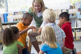 pic of student teacher  - Teacher in class showing students a nest - JPG