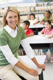 pic of student teacher  - Teacher in class with students in background  - JPG