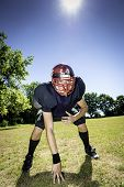 stock photo of lineman  - American football player offensive Lineman in three point stance - JPG