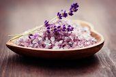 bowl of lavender bath salt with fresh flowers - beauty treatment