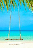 Swing on exotic sunny beach