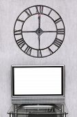foto of televisor  - mitnight time on wall clock under blank white screen of TV set - JPG