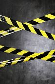 Black and yellow plastic barrier tape blocking the way.