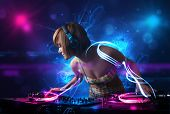 picture of disc jockey  - Beautiful disc jockey playing music with electro light effects and lights - JPG