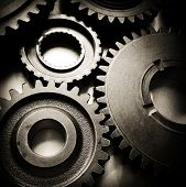stock photo of interlocking  - Closeup of metal cog gears - JPG