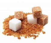 stock photo of sugar cube  - Brown and white cane sugar cubes isolated - JPG