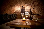 stock photo of keg  - Wine cellar with wine bottle and glasses - JPG