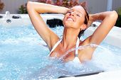 image of sauna woman  - Beautiful woman relaxing in a hot tub - JPG