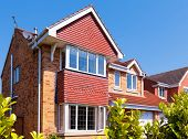 stock photo of suburban city  - Red brick house - JPG