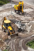 stock photo of bulldozers  - Repair of heating bulldozer digging the ground - JPG