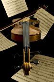 Floating Violin And Notation Sheets