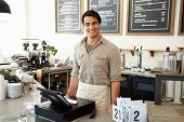 stock photo of apron  - Male Owner Of Coffee Shop - JPG