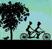 Couple Biking In The City